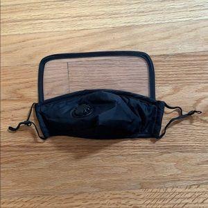 Black mask with shield. Filter/adjustable strings